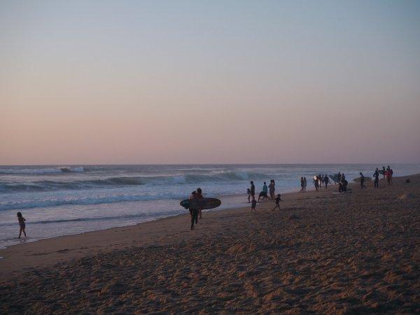 Surfen mit Sonnenuntergang